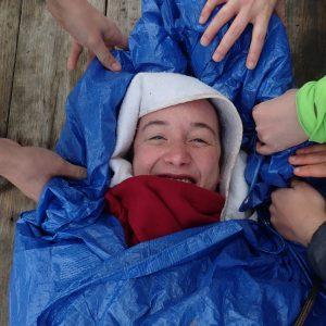 Student in emergency blanket